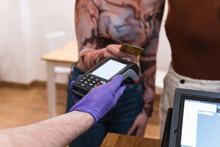 Unrecognizable Women Making Payment In Restaurant