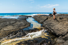 Female Hiker And Tide Pools Formed In Ancient Lava Flows On Puhili  Point, Honokohua National Historic Park, Hawaii Island, Hawaii, USA