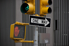 MANHATTAN, NEW YORK - MAY 7, 2014: Sign And Traffic Lights In The City.