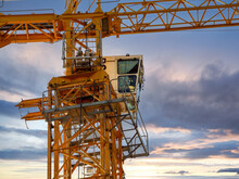 Tower Crane Cabin Against The Backdrop Of The Sunset Sky. Close-up. Industrial Background.