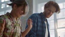 Joyful Couple Having Fun During Home Repair Indoors. Family Dancing In House.