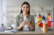 Cheerful asian young lady using smartphone, having English class