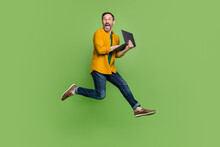 Full Length Profile Side Photo Of Mature Man Happy Positive Smile Typing Laptop Jump Isolated Over Green Color Background