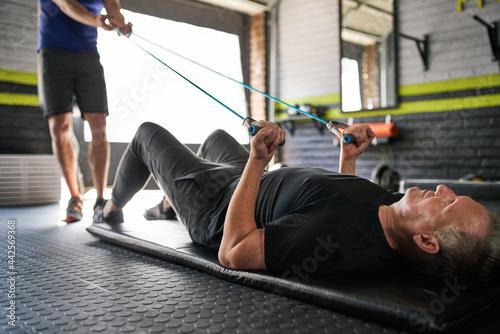 Personal trainer holding resistance bands Fotobehang
