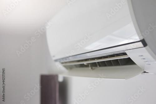 Fotografia, Obraz Air conditioner on white wall room interior background