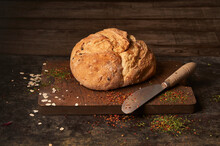 Fresh Baked Bread On Table With Herbs