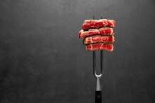 Studio Shot Of Slices Of Steak On A Meat Fork