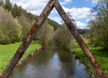 Tranquil River Or Canal Through Triangular Bridge Supports