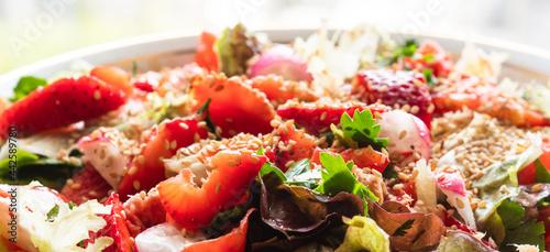 Fotografie, Obraz Fresh summer healthy fiber protein vitamin salad in bowl with strawberries, lett