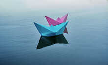 Two Boats Of Blue And Pink Color, Swim On The River. Summer Day, Rest On The Pond