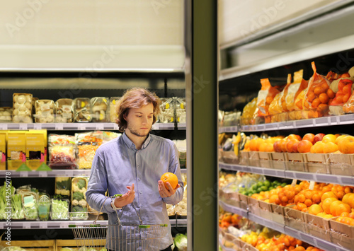 Fototapeta Man buying fruits and vegetables  at the market