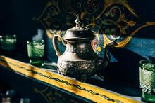 Composition Of Ornamental Tea Sets On Shelves