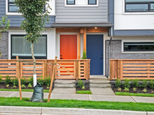 Red And Blue Doors Of Brand New Residential Townhouses
