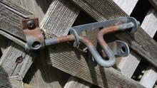 Rusty Metal Latch On A Wooden Lattice Door