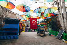 Colorful Umbrellas And Turkish Flag Over Pavement
