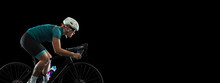 Professional Young Female Cycler On Road Bike Isolated Over Black Studio Background.