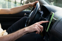 Anonymous Man Using GPS Navigator In Car