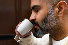 Crop Masculine Hispanic Man Smelling Coffee From Cup