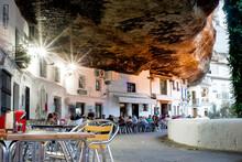 Tourist Enjoying Good Food And Drinks In The Restaurants Of Setenil De Las Bodegas, Spain