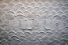 Japanese Zen Garden Raked With The Word JAPAN In Capital Letters In Textured White Sand With Wave Pattern
