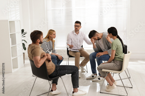 Fotografie, Obraz Psychotherapist working with group of drug addicted people at therapy session in