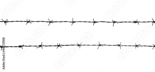Fotografia, Obraz black barbed wire fence. Security, isolated