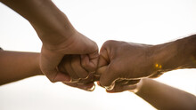 Close Up Bottom View Of People Giving Fist Bump Showing Unity And Teamwork. Friendship Happiness Leisure Partnership Team Concept.