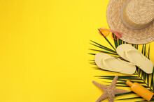 Flat Lay Composition With Beach Objects On Yellow Background, Space For Text