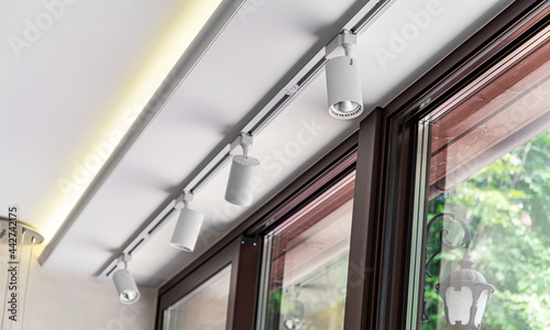 Obraz na plátně Modern lamps under the ceiling as an interior element.