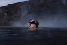 Woman With Goggles Diving Into The Sea Sticking Out The Tongue