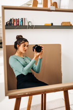 Photographer With Photo Camera Against Mirror At Home