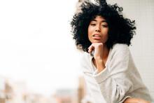 Serene Black Woman Standing On Balcony