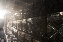 Bitcoin ASIC Miners In Warehouse. ASIC Mining Equipment On Stand Racks For Mining Cryptocurrency In Steel Container. Blockchain Techology Application Specific Integrated Circuit Units Storage.