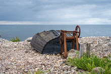 An Old Wooden Boat On The Seashore. Picture From The Baltic Sea. Blue Sky And Ocean In The Background.