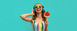 Summer colorful portrait of cheerful happy laughing young woman in headphones listening to music with juicy lollipop or ice cream shaped slice of watermelon on blue background