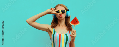 Valokuva Summer colorful portrait of stylish young woman in headphones listening to music