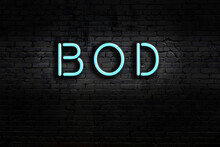 Neon Sign. Word Bod Against Brick Wall. Night View