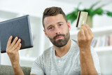 man with tablet and credit card