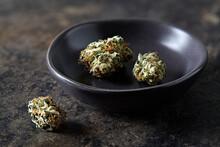 Still Life Of Cherry Kush Cannabis Buds In Bowl