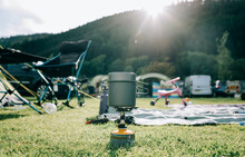 Small Portable Cooking Stove Boiling Water On A Family Campsite