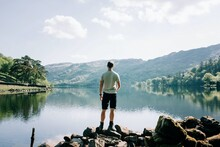 Man Enjoying The View Of The Welsh Mountains And Lakes In The UK