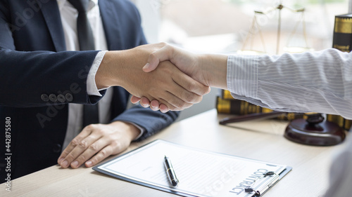 Fotografia, Obraz Businessman shaking hands with a lawyer or judge After signing the contract and the agreement is complete, Approval of an agreement between business and law, End of the legal case