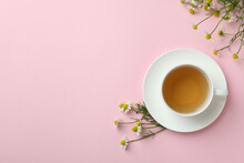 Cup Of Chamomile Tea On Pink Background