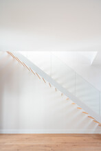 Stairs Near White Wall In Modern House