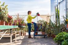 Female Buyer Shopping In Garden Center