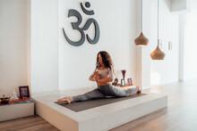 Calm Woman Doing Yoga In Splits Pose