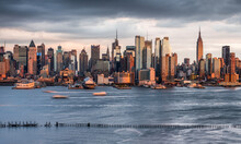 Manhattan Skyline Panorama Along The Hudson River At Sunset, New York City, USA