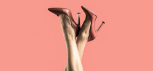 Pretty Female Legs With Red High Heels On Red Background. Perfect Female Legs Wearing High Heels. Shapely Legs, A Girl In Shoes High-heeled