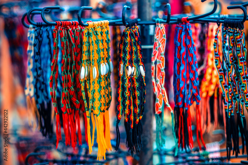 Canvas-taulu Close up view of colorful handmade bracelets assortment for sell
