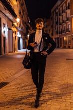 Stylish Transsexual Man Walking On City Street At Night